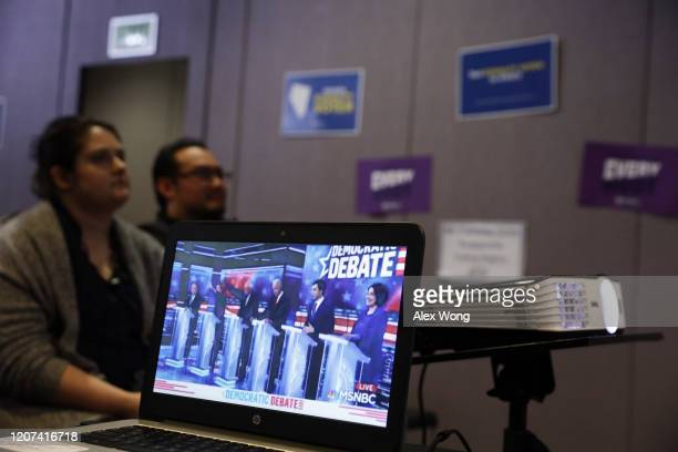 People participate in a Democratic presidential primary debate watch party at Las Vegas LGBT Center February 19 2020 in Las Vegas Nevada Six...