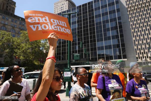 People participate in a demonstration and news conference against illegal guns in front of the Jacob Javits Federal Building on August 12, 2019 in...