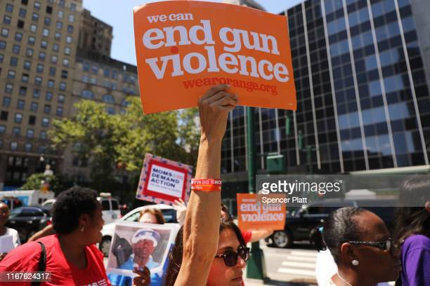 People participate in a demonstration and news conference against illegal guns in front of the Jacob Javits Federal Building on August 12 2019 in New...