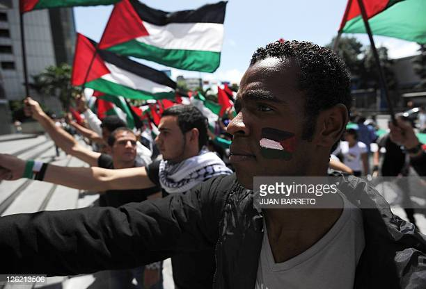 People participate in a demonstration in support of the Palestinian statehood recognition at the United Nations outside the headquarters of the UN in...