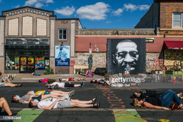 People participate in a die-in during a demonstration on August 17, 2020 in Minneapolis, Minnesota. Community members came together for a rally to...