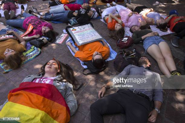 People participate in a diein on the twoyear anniversary of the Pulse nightclub mass shooting to remember the victims and call for an end to gun...