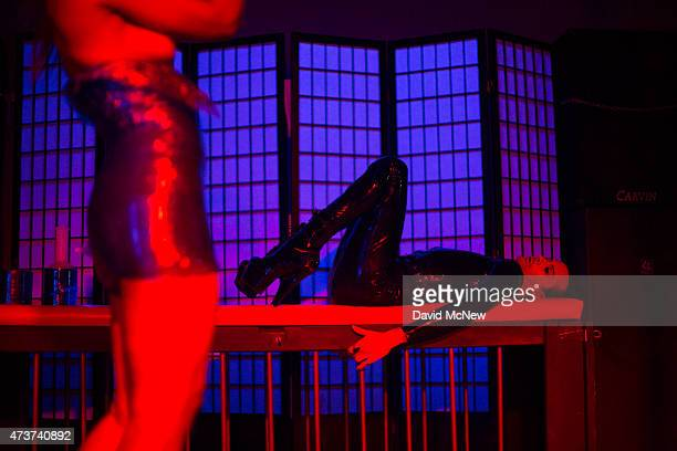 People participate in a dungeon party during the domination convention DomCon LA on May 16 2015 in Los Angeles California The annual convention which...