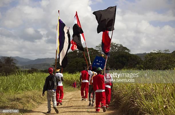 People participate in a Gaga ceremony at the batey La Romana Dominican Republic on April 3 2015 The Gaga ritual is a combination of Santeria Vodoo...