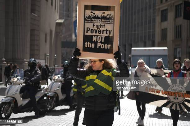 People participate in a march for the Poor People's Campaign in the Financial District on March 18 2019 in New York City Calling itself 'a national...