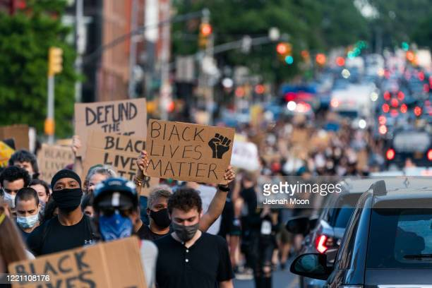 People participate in a march in Brooklyn for both Black Lives Matter and to commemorate the 155th anniversary of Juneteenth on June 19 2020 in New...