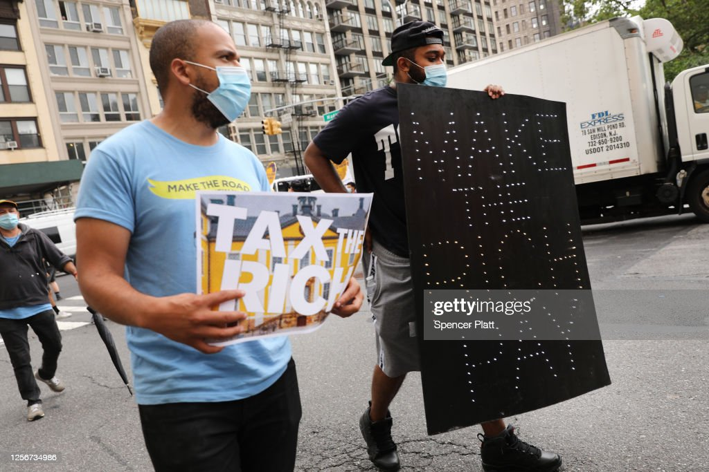Activists March In Manhattan Calling For A Tax On Billionaires : News Photo