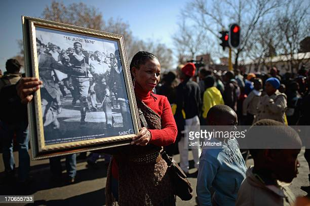 People participate in a march to commemorate Youth Day in Soweto Township on June 16, 2013 in Johannesburg, South Africa. Youth Day commemorates the...