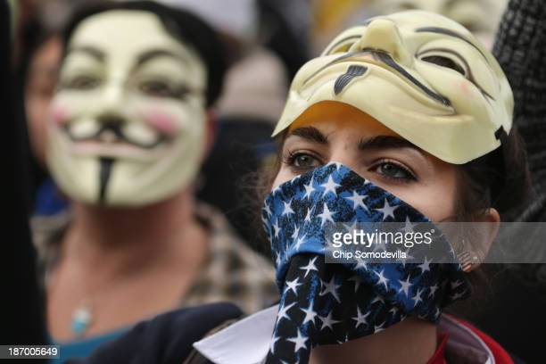 """People participate in a march to the U.S. Capitol during the """"Million Mask March"""" November 5, 2013 in Washington, DC. Organized by members of..."""