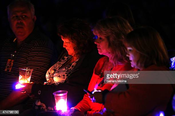 People participate in a memorial in People's Park on MAy 23 2015 in Isla Vista Calfornia in remembrance of those who were killed and injured by...