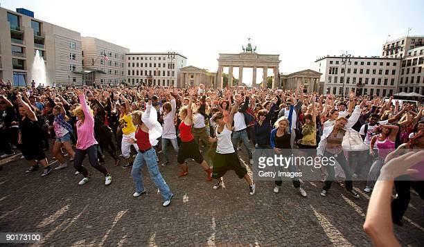People participate in a Michael Jackson Tribute flashmob in front of the Brandenburg Gate on August 29 2009 in Berlin Germany