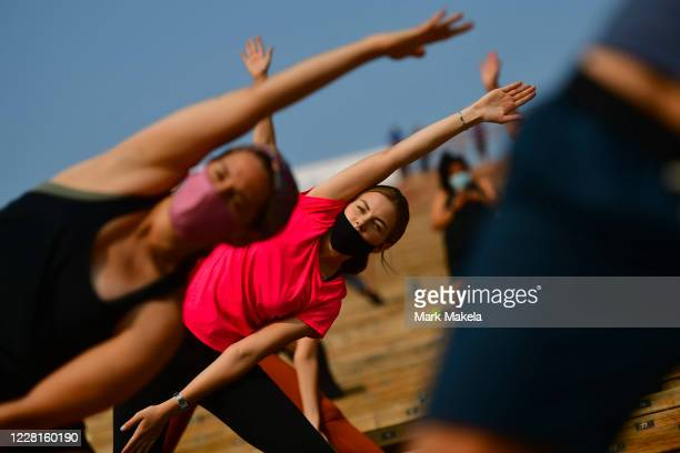 People participate in a morning yoga session on August 22, 2020 at the Red Rocks Amphiteatre in Morrison, Colorado. The famed concert locale features...