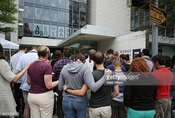 People participate in a prayer in front of the Human Rights Campaign building, June 17, 2016 in Washington, DC. Images of the 49 people killed in the...