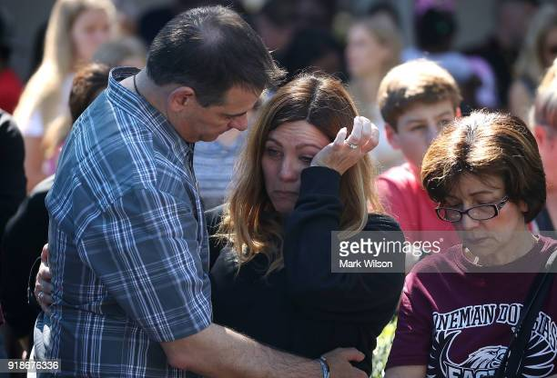 People participate in a prayer vigil for famlies of Marjory Stoneman Douglas High School where a mass shooting took place at the Parkridge Church on...