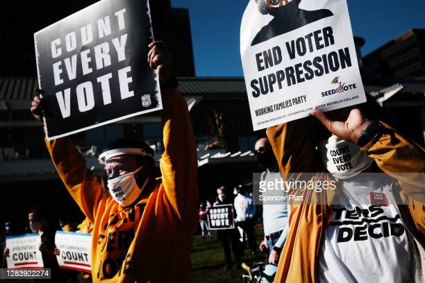 People participate in a protest in support of counting all votes as the election in Pennsylvania is still unresolved on November 04, 2020 in...
