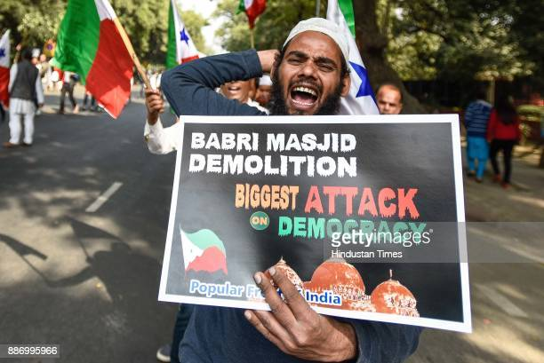 People participate in a protest march held under the banner of Lok Raj Sangathan on the 25th anniversary of Babri Mosque Demolition from Mandi House...