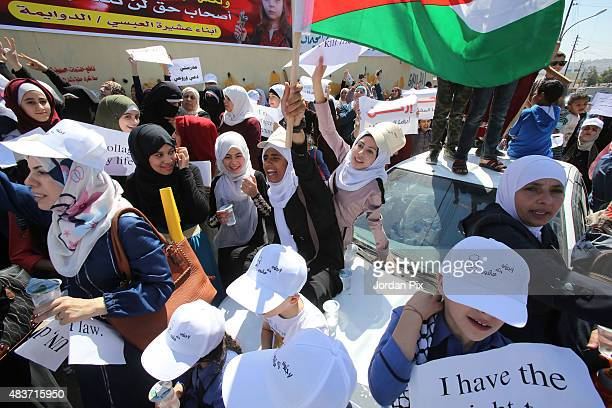 People participate in a protest to denounce plans of downsizing services to Palestinian refugees benefiting from the United Nations Relief and Works...