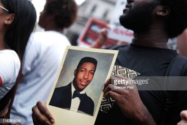 People participate in a protest to mark the five year anniversary of the death of Eric Garner during a confrontation with a police officer in the...