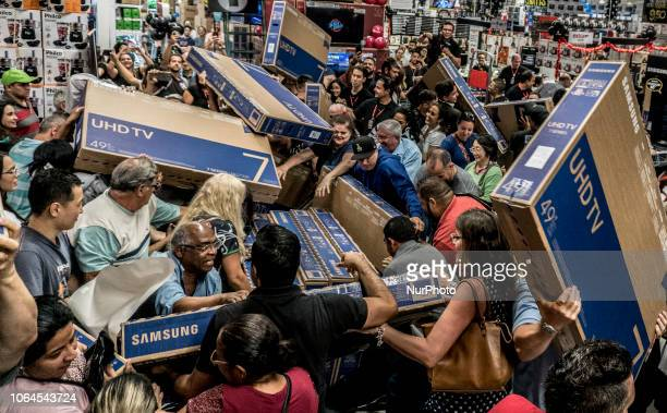 """People participate in a """"Black Friday"""" event in São Paulo, Brazil, on November 23, 2018. """"Black Friday"""" is a term created in the..."""