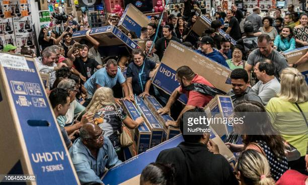 People participate in a quotBlack Fridayquot event in São Paulo Brazil on November 23 2018 quotBlack Fridayquot is a term created in the United...