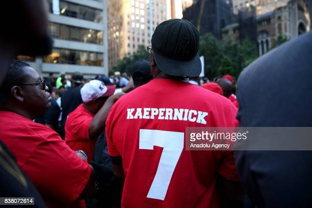 People participate in a rally against the National Football League supporting Colin Kaepernick in Manhattan borough of New York United States on...