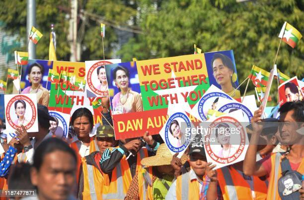 People participate in a rally in support of Myanmar's State Counsellor Aung San Suu Kyi as she prepares to defend Myanmar at the International Court...