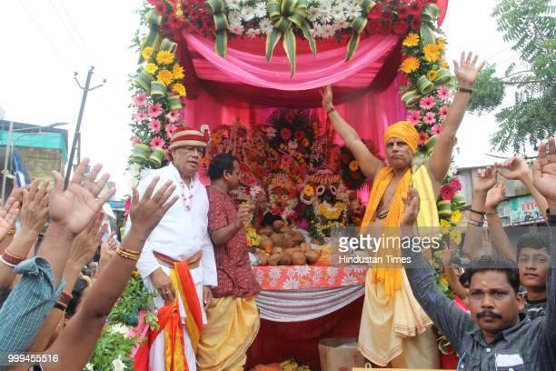 People participate in a Rath Yatra of Lord Jagannath organised by Jai Jagannath Loktaran Trust at Kharghar on July 14 2018 in Navi Mumbai India The...