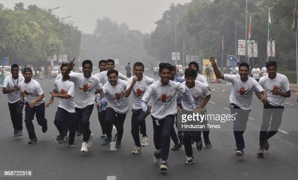 People participate in a 'Run for Unity' on the birth anniversary of 142nd Sardar Vallabhbhai Patel at Major Dhyan Chand National Stadium on October...