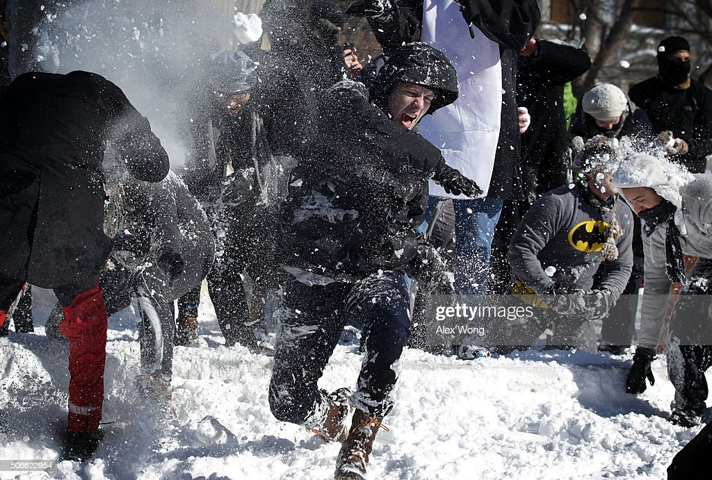 People participate in a snowball fight at Dupont Circle January 24, 2016 in Washington, DC. The blizzard that has brought massive snowfall and a standstill to the East Coast and the Mid Atlantic region has stopped.