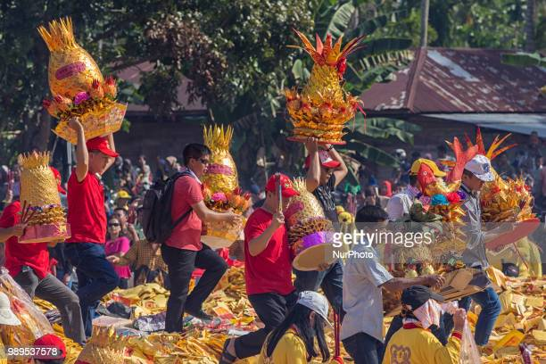 People participate in Bakar Tongkang Festival or the barge burning tradition in BagansiapiApi Riau Indonesia on June 30 2018 A paper barge is paraded...