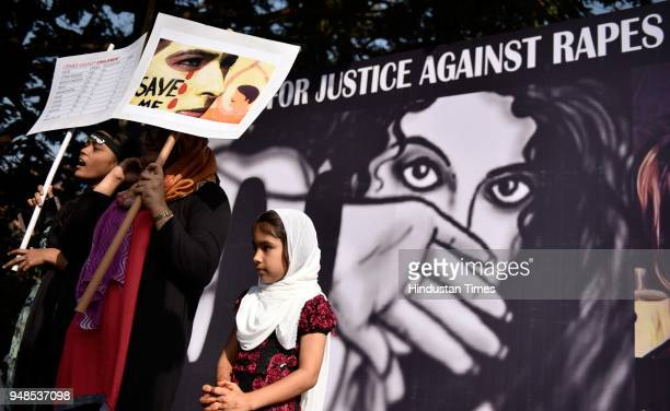 People participate in peaceful march for justice against rapes and murders at Bandra, on April 18, 2018 in Mumbai, India.