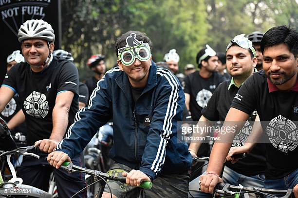 People participate in Pedal for the Planet Walkathon/Cyclathon organized by WWF to celebrate Earth Hours on March 19 2016 in New Delhi India Each...
