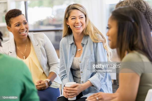 people participate in support group session - mid adult women stock pictures, royalty-free photos & images