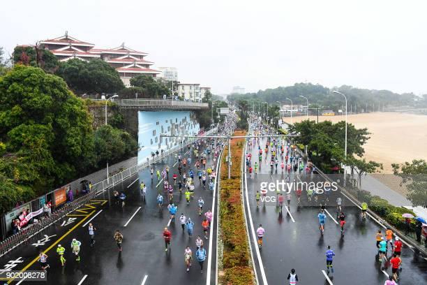 People participate in the 2018 CD Xiamen Marathon in the rain on January 7 2017 in Xiamen Fujian Province of China