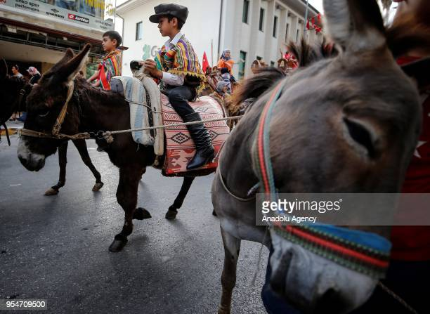 People participate in the 4th International Antalya Yoruk Festival with their donkeys on May 04 2018 in Antalya Turkey