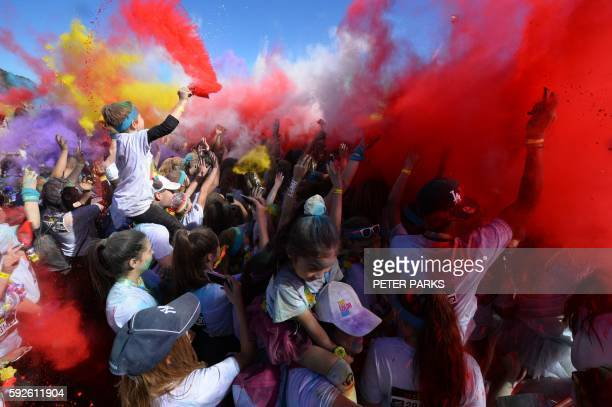 People participate in the annual Color Run after party in Centennial Park in Sydney on August 21 2016 The Color Run is a 5km fun run started in the...
