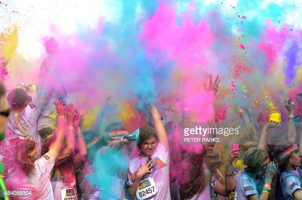 People participate in the annual Color Run in Sydney on August 24 2014 The Color Run is a 5km fun run which has passed through 30 cities in the US...