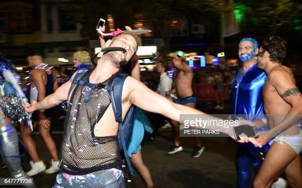 People participate in the annual Gay and Lesbian Mardi Gras parade in Sydney on March 4 2017 Thousands of revellers took part in iconic festival...