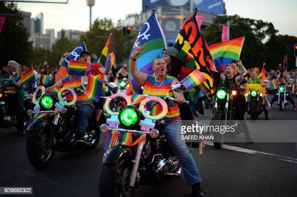 People participate in the annual Gay and Lesbian Mardi Gras parade in Sydney on March 3 2018 Rainbow colours beamed from faces and floats parading...