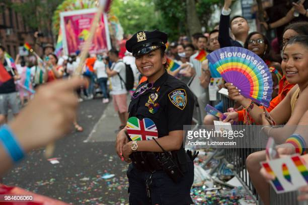 People participate in the annual gay pride parade as it winds its way through the streets of Greenwich Village June 24 2018 in New York City