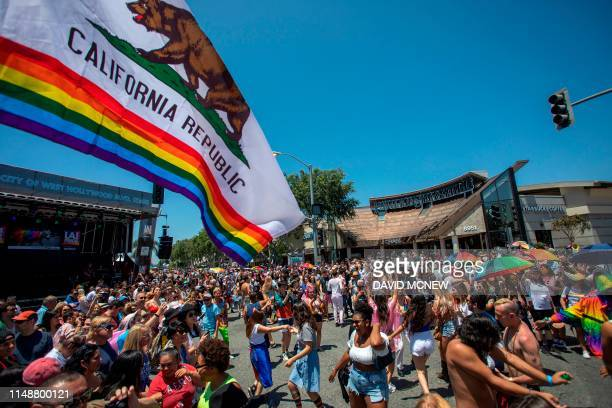 People participate in the annual LA Pride Parade in West Hollywood California on June 9 2019 LA Pride began on June 28 exactly one year after the...
