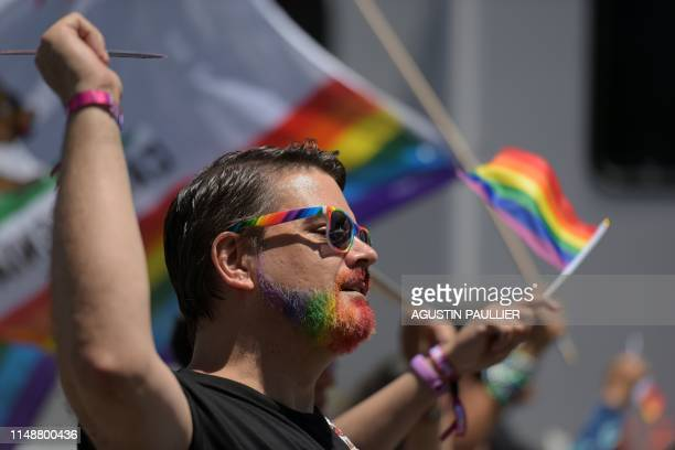 People participate in the annual LA Pride Parade in West Hollywood, California, on June 9, 2019. - LA Pride began on June 28 exactly one year after...