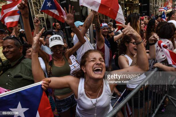 People participate in the annual Puerto Rican Day Parade marching up 5th Ave on June 11 2017 in New York City Tensions were heightened at this year's...