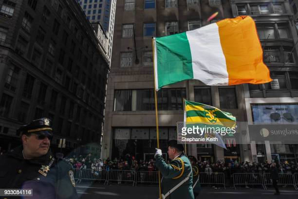 People participate in the annual St Patrick's Day parade along 5th Ave on March 17 2018 in New York City New York's Saint Patrick's Day parade is the...