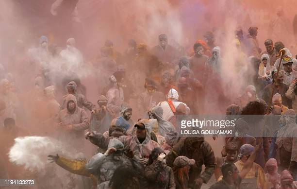 People participate in the colourful flourwar during celebrations of the Clean Monday marking the end of carnival and the start of the 40days Lent...