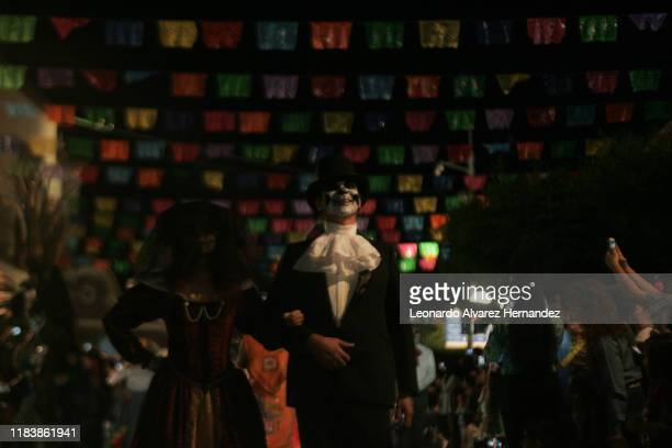People participate in the Festival de la Muerte in the streets of Tlaquepaque dressed as Catrina prior the day of the dead celebrations on October 27...