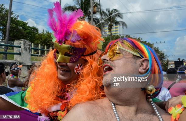 People participate in the gay pride parade during the celebration of the day against homophobia and transphobia in Havana on May 13 2017 / AFP PHOTO...