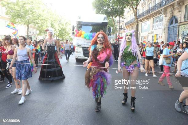 People participate in the Gay Pride Parade rally and march in the streets on June 24 2017 in Paris France