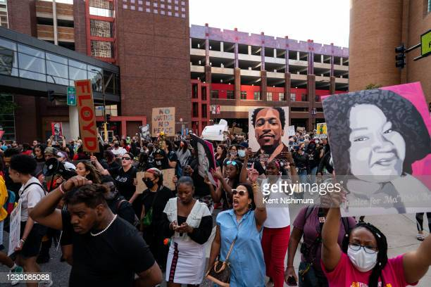 People participate in the inaugural remembrance rally and march hosted by the George Floyd Global Memorial, commemorating the first anniversary of...