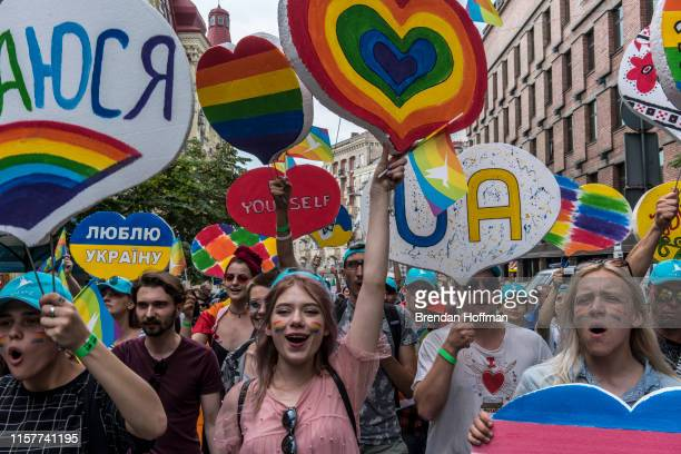 People participate in the Kyiv Pride march estimated to be the city's largest ever on June 23 2019 in Kiev Ukraine The parade has been marked by...
